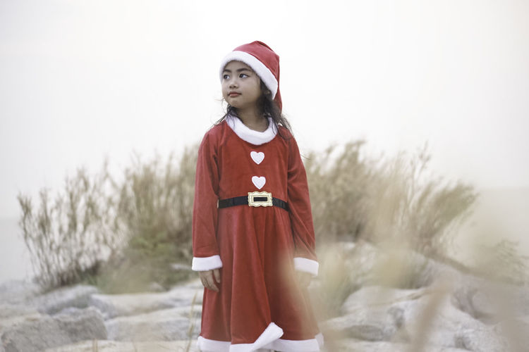 My little Santy. Santy  Santa Claus Christmas Grass Winter Field Dried Plant Seascape Sea Side Sattahip Thailand Merry Christmas! New Year Red Dress Kid Girl Little Girl One Person Standing Clothing Child Offspring Childhood Hat Nature Looking Girls Three Quarter Length Front View Cold Temperature Day Snow Portrait Warm Clothing Outdoors Innocence 2018 In One Photograph