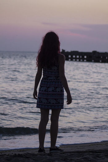 EyeEm Best Shots EyeEm Nature Lover EyeEm Selects EyeEm Gallery EyeEmNewHere Peace Tranquility Beach Beauty In Nature Canon Full Length Hairstyle Land Long Hair Nature Outdoors Peaceful Real People Rear View Sea Sky Standing Sunset Water Women