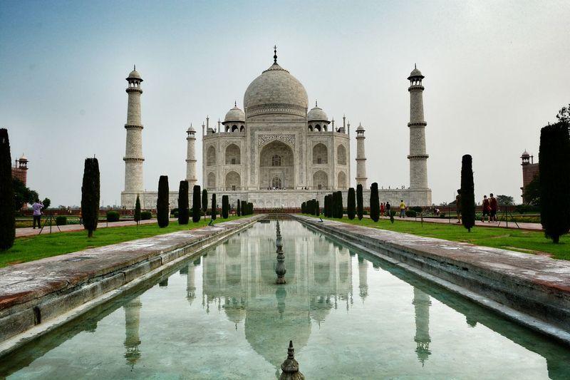 Reflecting pool against taj mahal in city