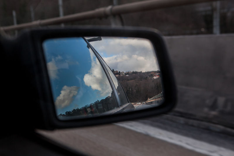 In my rear view mirror Rearview Mirror Car Close-up Day Glass - Material Land Vehicle Nature No People Outdoors Rear View Mirror Rearviewmirror Reflection Review Side-view Mirror Sky Transportation Vehicle Mirror Window