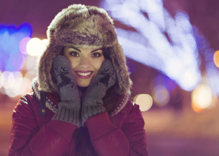 Portrait of smiling young woman during winter