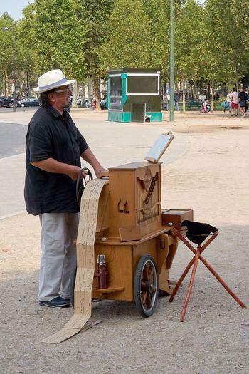 An organ grinder near the Eiffel Tower, Paris One Person Organ Grinder Paris