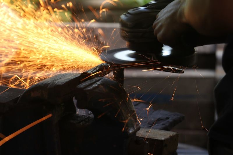 Grinder Working Sparks Occupation Metal Metal Industry Grinding Indoors  Men Industry Motion Welding One Person Cutting Long Exposure Manual Worker Skill  Factory Heat - Temperature Welder