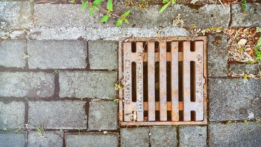 View of manhole on metal grate