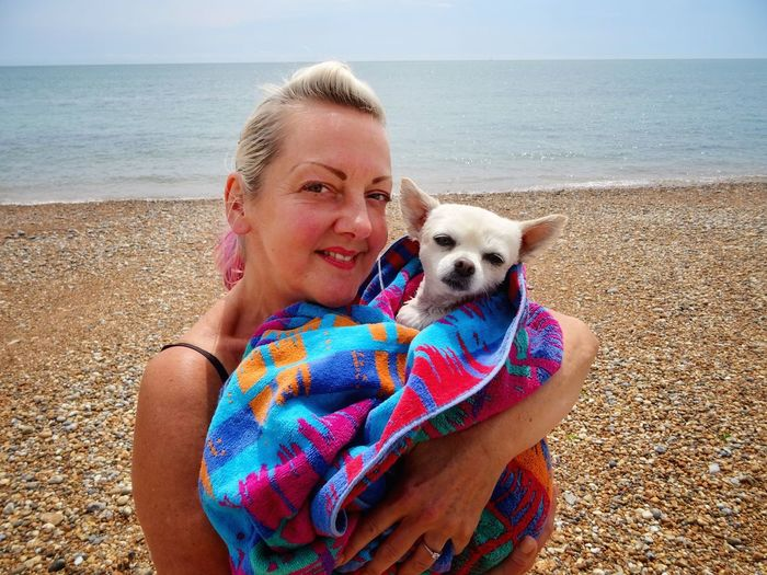 Portrait Of Woman Dog At Beach