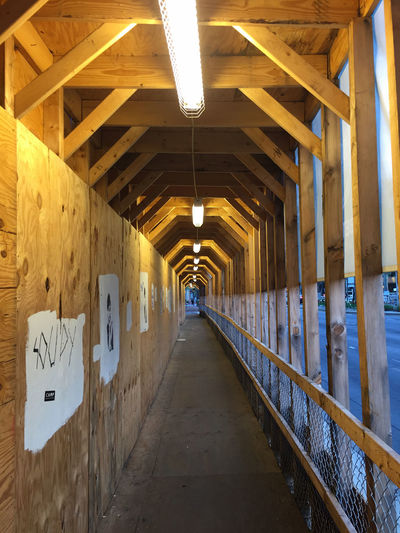 Absence Architectural Column Architecture Building Built Structure Chipboard Corridor Day Diminishing Perspective Empty In A Row Lights Long Narrow No People The Way Forward Vanishing Point Walkway Wood - Material