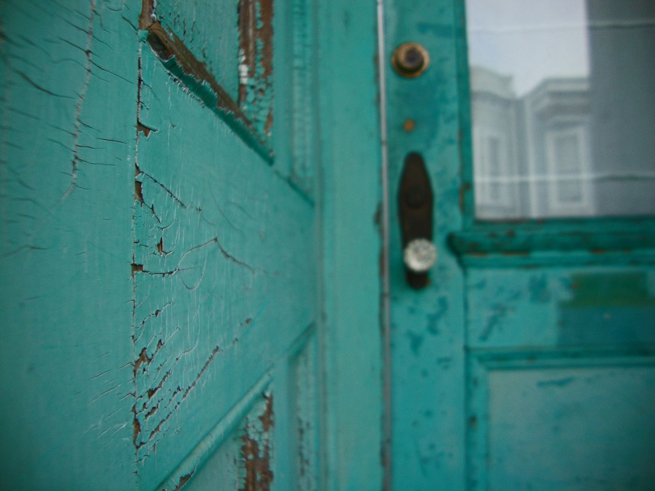 Close-up of green old wooden house door