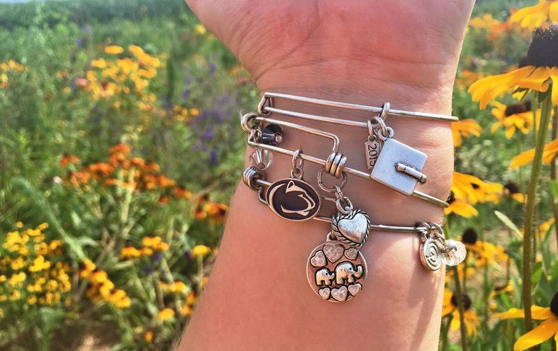 I wanna be surrounded by beautiful things 🌺🌻🌼🌸🌷🌹 Close-up Person Focus On Foreground Pendant Outdoors Outdoor Photography Photography Bracelet Bracelet Love Pennstate Graduation Elephant Elephants Heart Lion Flowers Nature Wildflowers Nature_collection Beauty In Nature IPhoneography Iphonephotography