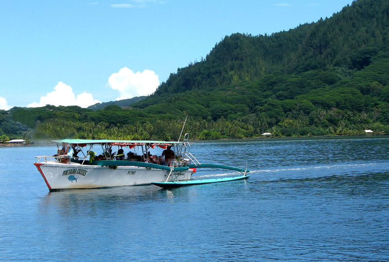 French Polynesia South Pacific Island Beauty In Nature Boat Trips Day Huahineisland Leeward Islands Men Mountain Nature Nautical Vessel Outdoors People Real People Scenics Sea Shore Excursions Sky Transportation Tree Vacations Water