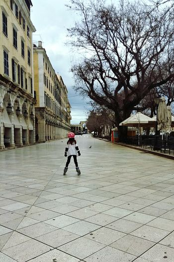 child skating in an empty square ❤ Architecture Full Length Building Exterior Built Structure Child Childhood Day Outdoors Sky City EyeEmNewHere Colour Your Horizn
