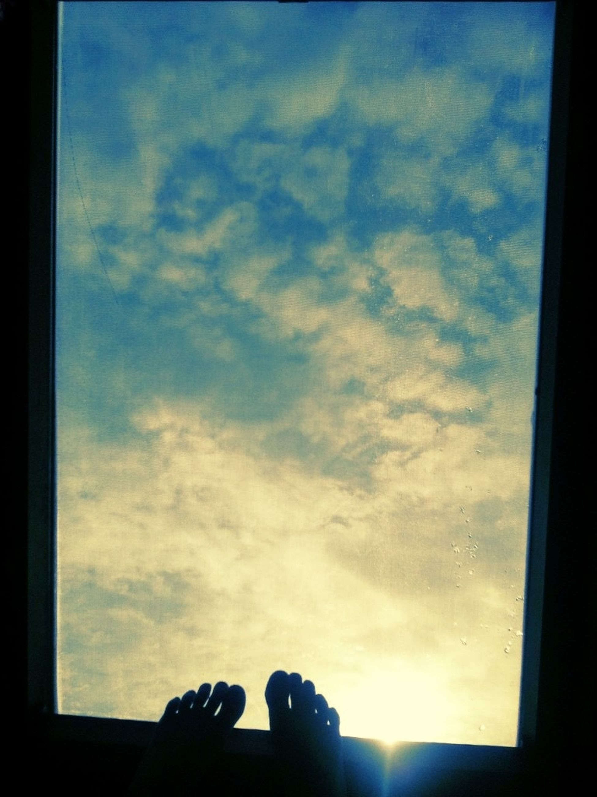 sky, silhouette, window, cloud - sky, low angle view, cloud, indoors, glass - material, built structure, cloudy, architecture, sunset, building exterior, sunlight, nature, house, transparent, auto post production filter, no people, beauty in nature