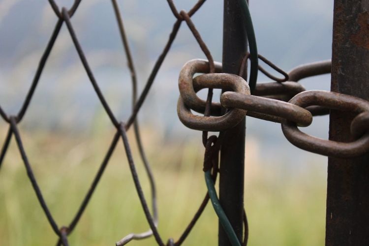 Close-up of chain on chainlink fence
