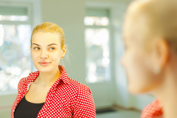 Close-Up Of Woman Reflecting In Mirror