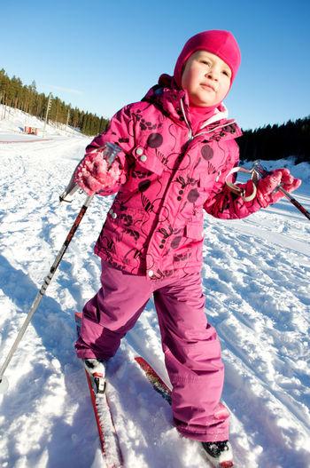 Full length of girl skiing on snow