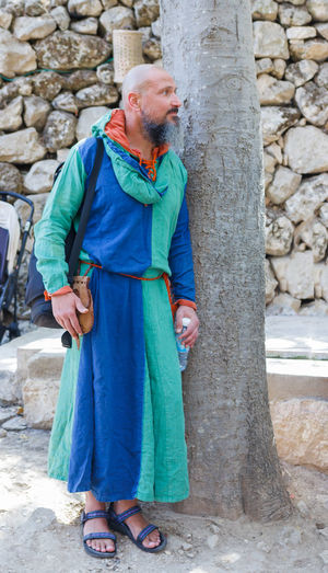 "Jerusalem, Israel, October 03, 2016: Member of the annual festival of ""Knights of Jerusalem"", resting near a tree in Jerusalem, Israel Ancient Annual Attraction Christian Citizen Decorations Dressed Event Famous Festival History Holy Israel Jerusalem Knight  Land Medieval Member Old Performance Performs Photographer Pose Sword Tradition"