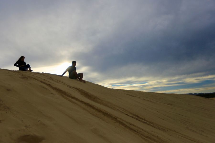 Silhouette of sand boarder at sand dune Sky Cloud - Sky Real People Landscape Land Scenics - Nature Leisure Activity Nature Sand Beauty In Nature Environment Men Desert Lifestyles Two People Sand Dune People Unrecognizable Person Ride Riding