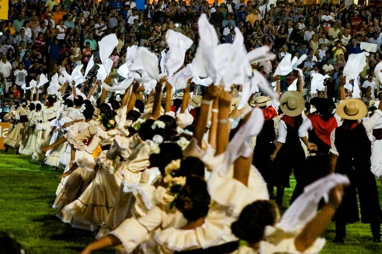 Large group of people dressed as gauchos performing the opening of the National Festival of Taming and Folklore 2015 in afiteatro de Jesus Maria, Argentina on Thursday night January 8, 2015 The Photojournalist - 2015 EyeEm Awards
