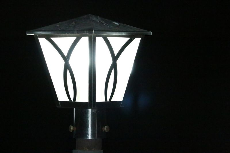 Close-up of illuminated lamp in dark room