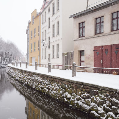 view of snow covered buildings in city Historical Building Mecklenburg-Vorpommern Winter Winterscapes Architecture Bare Tree Building Exterior Built Structure Cold Temperature Day Germany Nature No People Old Buildings Oldtown Outdoors Philipp Dase Sky Snow Snow Covered Winter Winter In The City Wismar