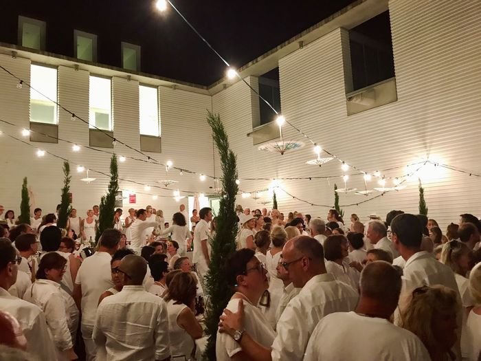 Quartier blanc - the white dinner and party in Ludwigsburg, Germany on July 22, 2017 Large Group Of People Night Illuminated Celebration Lighting Equipment Men Real People Crowd Arts Culture And Entertainment Fun Togetherness Stage - Performance Space Women Building Exterior Audience Architecture People Adult Outdoors Diner En Blanc White Dinner White White Color Dressed In White