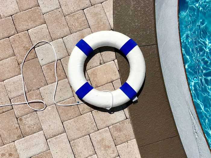 Dramatic Angles Photo 2 of 3. Week 1 of 10 Assignment. Kris Slater Paving Stone Cobblestone Blue Circle Outdoors EyeEm Personal Perspective Swimming Water Geometric Shape Iphone7photo Poolside Shooting Down Day Stone Material Pool Sunlight Safety Life Saver Drowning Life Preserver Art Photography