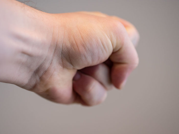 Close-up of human hand with clenching fist