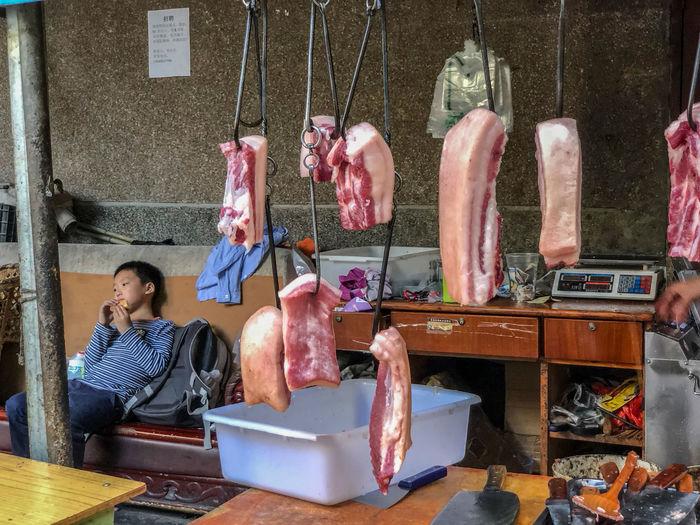 Market scene, Kunming China Food And Drink Indoors  Market Meat Pork Raw Food Retail Display Store