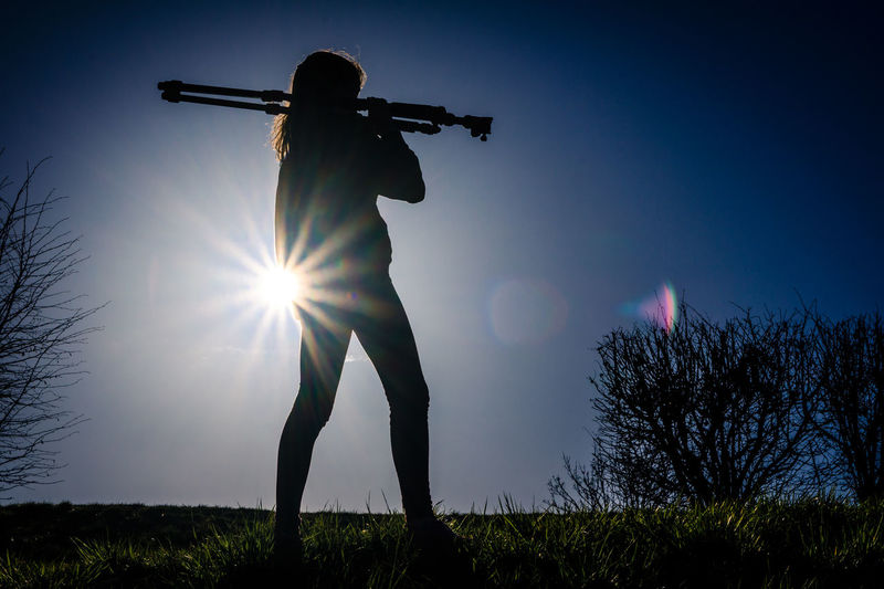 Photographer with his tripod Sun Star Sunset Silhouettes Woman Bright Field Full Length Gear Girl Grass Lens Flare Low Angle View Nature One Person Outdoors People Photographer Photography Plant Silhouette Sky Standing Sun Sunlight Sunset Sunstars