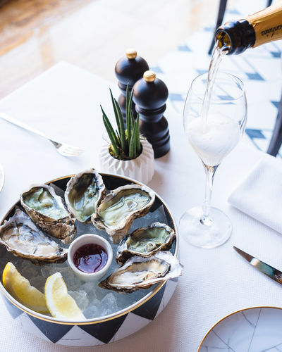 Food And Drink Freshness Table Plate Food Seafood Ready-to-eat Still Life No People Indoors  Glass Healthy Eating Wellbeing Refreshment Wine Serving Size Wineglass Close-up Oyster  Drink