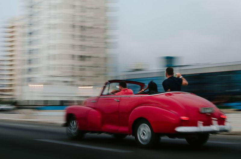 Máquina del Malecon Mode Of Transportation Motion Blurred Motion Transportation Motor Vehicle Land Vehicle City Car Architecture on the move Men Speed Red Built Structure Building Exterior Real People Adult Street City Life Two People Outdoors EyeEm Best Shots EyeEm Selects EyeEm Week A New Perspective On Life Human Connection