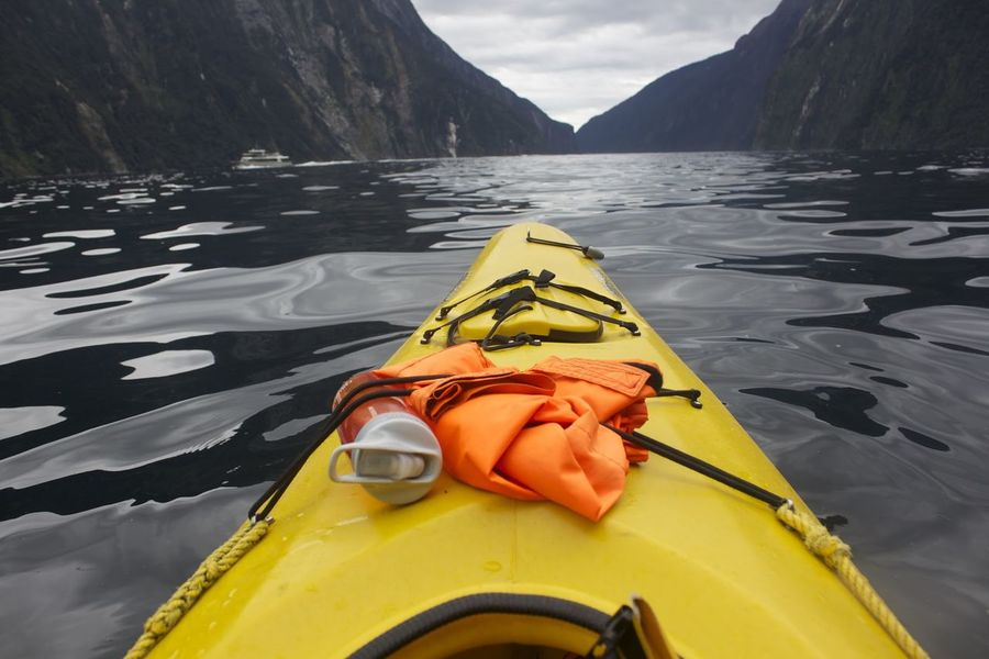 Calm Milford Sound Adventure Calm Water Close-up Day Kayak Kayaking Adve Kayaking In The Sea Kyaking Lake Mountains And Sea Mountains And Water Nature New Zealand No People Ocean Outdoors Serene Water Yellow
