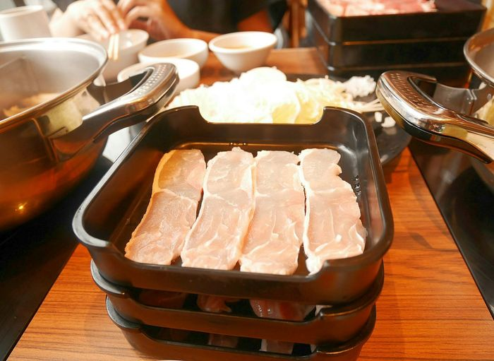 Close-Up Of Meat In Containers On Table