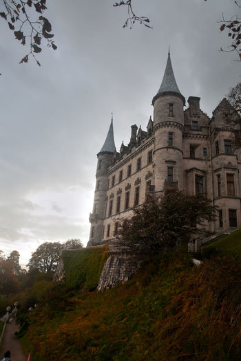 Dunrobin Castle in Golspie or a gloomy day Architecture Building Exterior Built Structure Caithness Caithness And Sutherland Castle Cloud - Sky Disney Dunrobin Castle DunrobinCastle Fairytale  Fairytale Castle Golspie Highlands Of Scotland History Medieval No People Outdoors Princess Scotland Scottish Highlands Sky Sutherland Tower Tree