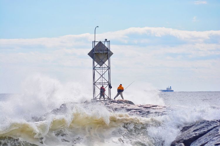 Hurricane off the coast brought in some heavy surf and brave fishermen