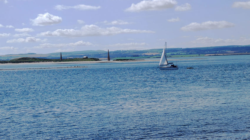 Looking towards Ross Links from Lindisfarne Blue Sky Boat Calm Lindisfarne Northumberland Outdoors Sea Seascape Yacht