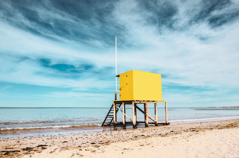 The yellow box Beach Life EyeEm Gallery Architecture Beach Built Structure Cloud - Sky Clouds And Sky Horizon Horizon Over Water Hut Land Lifeguard Hut Man Made Structure Nature No People Outdoors Protection Safety Sand Scenics - Nature Sea Security Sky Water Yellow