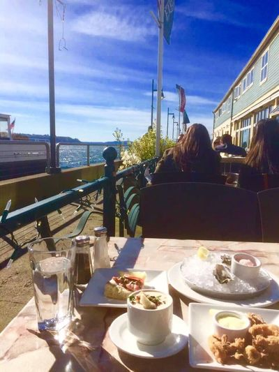 Table Eating Food Restaurant Women Sitting Food And Drink Chair Sky Plate Day Outdoors Healthy Eating Water People Adult Brunch Restaurant By The Sea Lunch Time! Ocean View Travel Seattle