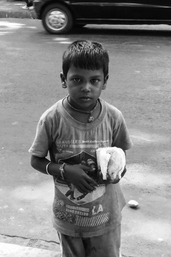 Portrait of boy standing on street