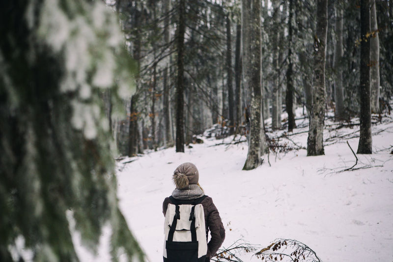 Full length of child in snow covered forest