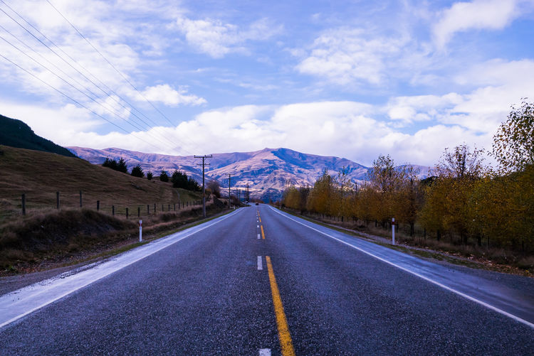 Beauty In Nature Cloud Cloud - Sky Cloudy Country Road Day Diminishing Perspective Empty Empty Road Landscape Long Mountain Mountain Range Nature No People Non-urban Scene Outdoors Road Road Marking Scenics Sky The Way Forward Tranquil Scene Tranquility Vanishing Point
