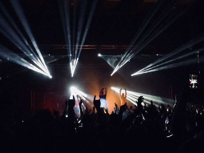 Crowd Large Group Of People Arts Culture And Entertainment Real People Group Of People Illuminated Performance Enjoyment Night Event Nightlife Stage - Performance Space Music Stage Lighting Equipment Youth Culture Popular Music Concert Audience Light Men