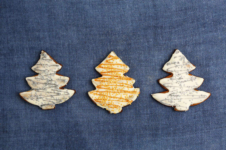 Christmas Cookies Gingerbread Homemade Food Decoration Colorful Colors Sweets Sweet Handmade Blue Background Textured  Textile Still Life Cookie Shape Indoors  Baked No People Design Sweet Food Food And Drink Jeans High Angle View Star Shape Pattern Group Of Objects Freshness Close-up Trees Three Quarter Length Shapes