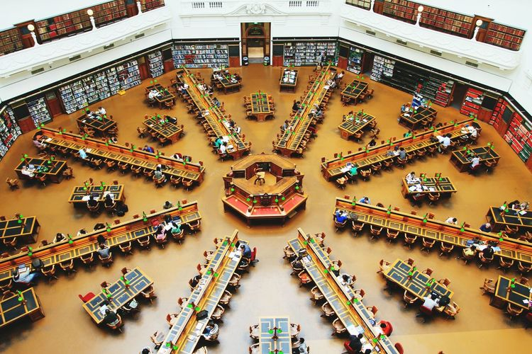 High Angle View Of People In Library