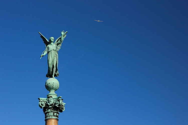 Copenhagen Copenhagen, Denmark Sculpture Flying In The Sky Airplane Taking Photos Blue Sky Nice Day Beautiful Sky Perfect Moment Angel Enjoying Life See The World Photography Taking Photos Hello World Monument In The Sky
