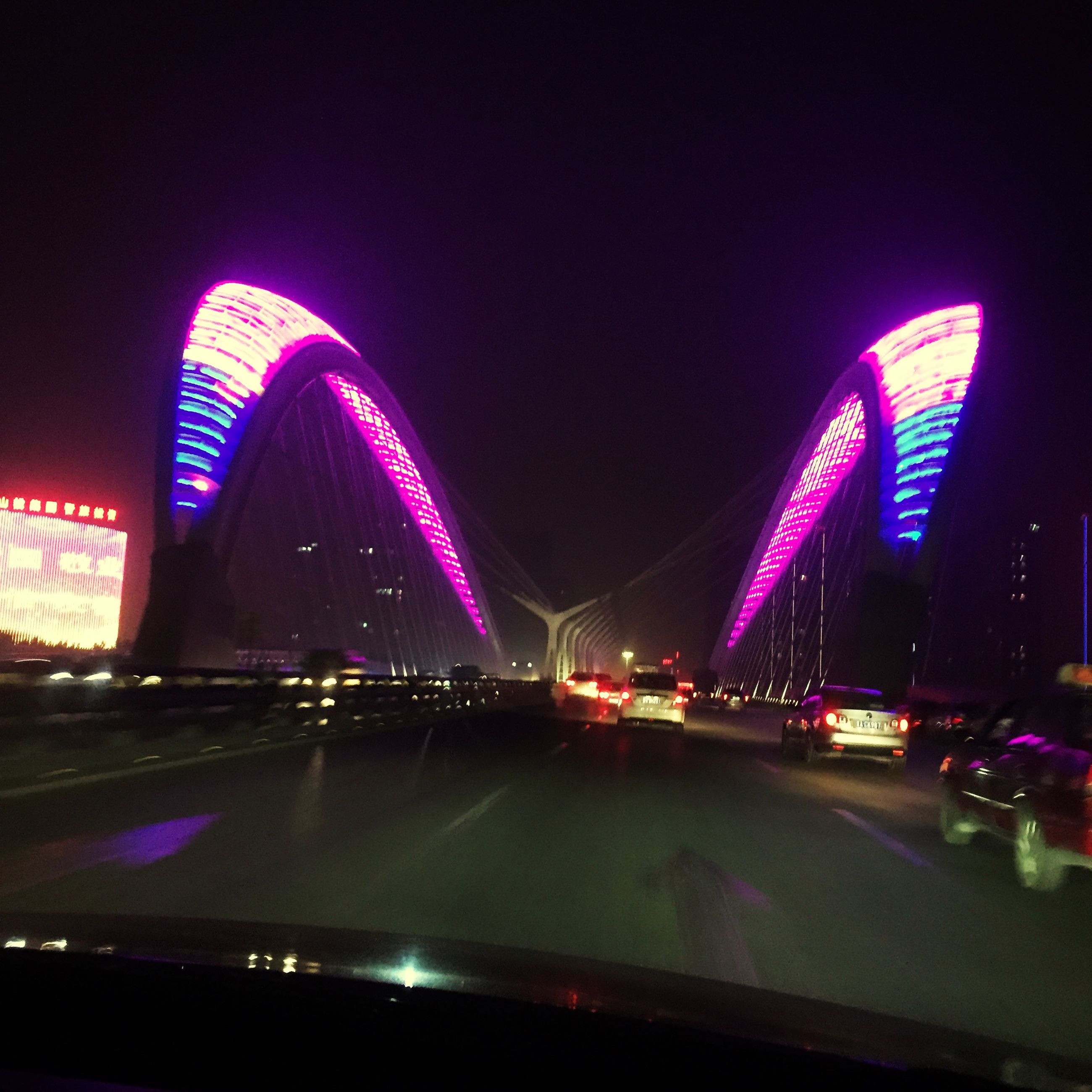 illuminated, night, architecture, built structure, transportation, bridge - man made structure, city, connection, light trail, long exposure, engineering, modern, speed, motion, travel destinations, road, building exterior, capital cities, travel, famous place
