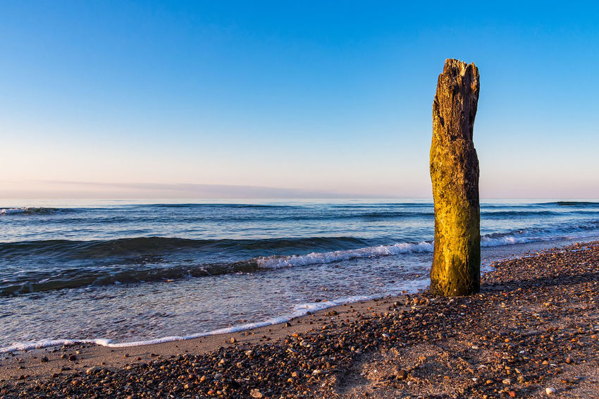 Evening on shore of the Baltic Sea. Baltic Sea Kuehlungborn Relaxing Beach Beauty In Nature Coast Day Groynes Horizon Over Water Kühlungsborn Nature No People Outdoors Rocks Scenics Sea Shore Sky Stones Tourism Tranquil Scene Tranquility Travel Destinations Vacation Water