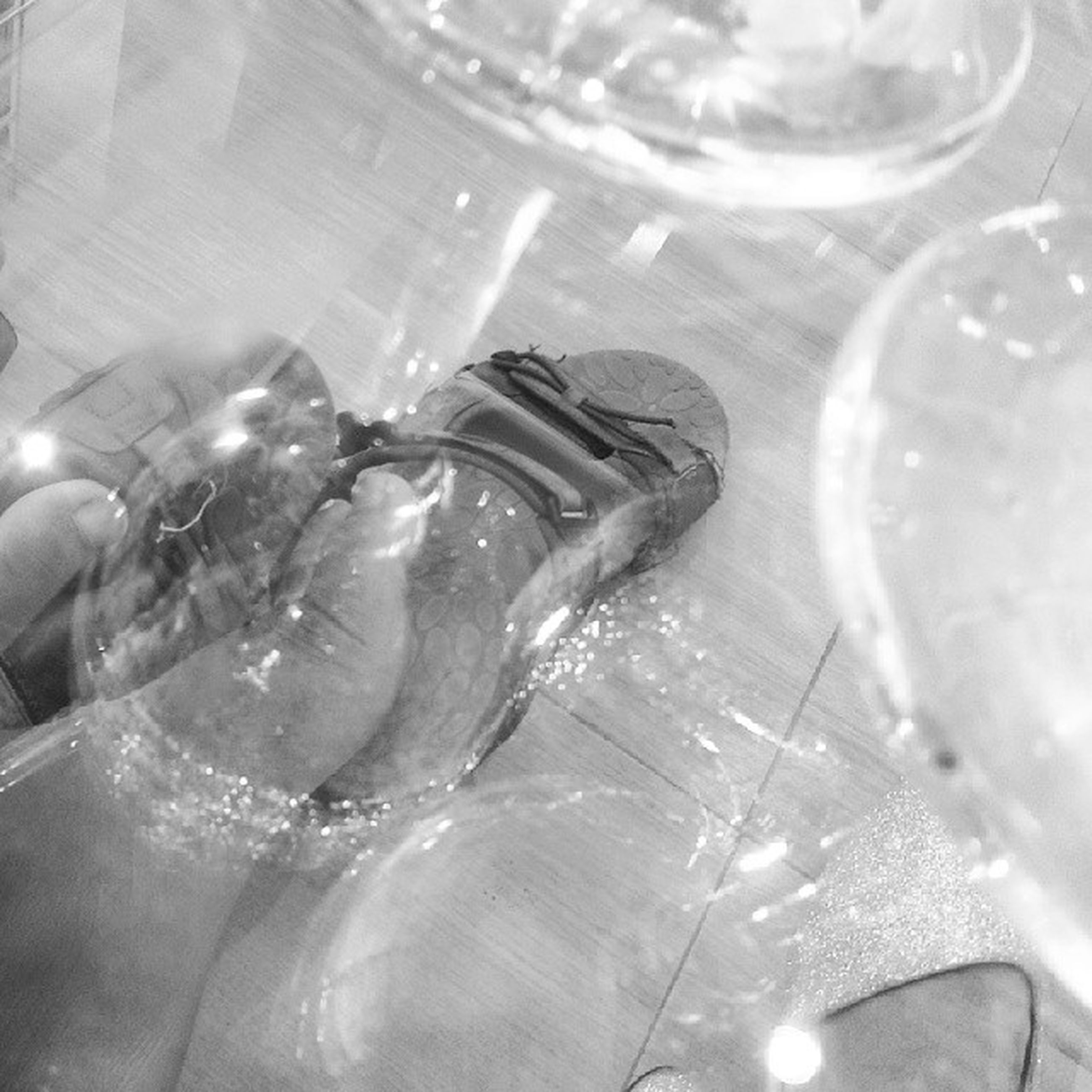 indoors, lifestyles, glass - material, transparent, leisure activity, person, high angle view, refreshment, close-up, bubble, part of, water, drinking glass, men, unrecognizable person, drink