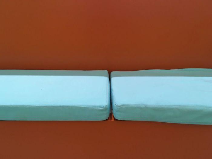 Mattress against brown background