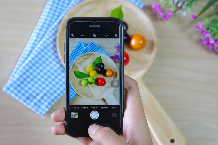 Midsection Of Person Photographing With Fruits With Smart Phone
