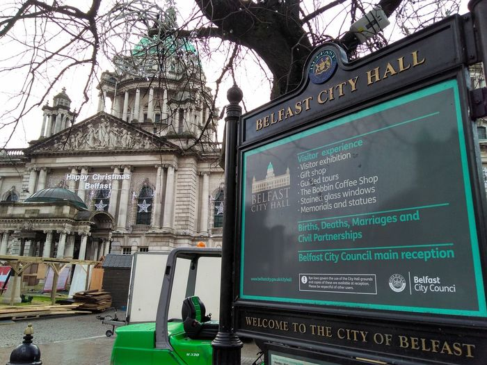 the front of Belfast's city hall Council City Text Architecture Built Structure Television Tower Non-western Script Information Sign Information Western Script Capital Letter Written Signboard Warning Information Symbol